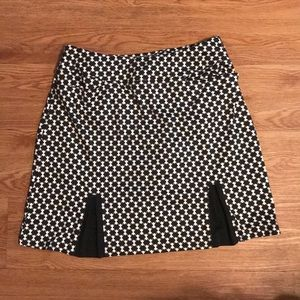 Tail Mini Skirt with built in boy shorts. Fit: M.